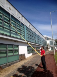 our window cleaning teams use the Reach and Wash system